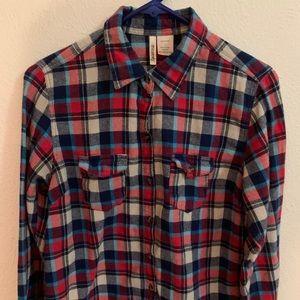 Long-sleeve button up Plaid shirt.